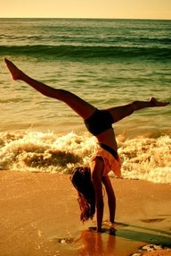 I love gymnastics on the beach! karisa we are gonna go to some cool place this summer and do this!