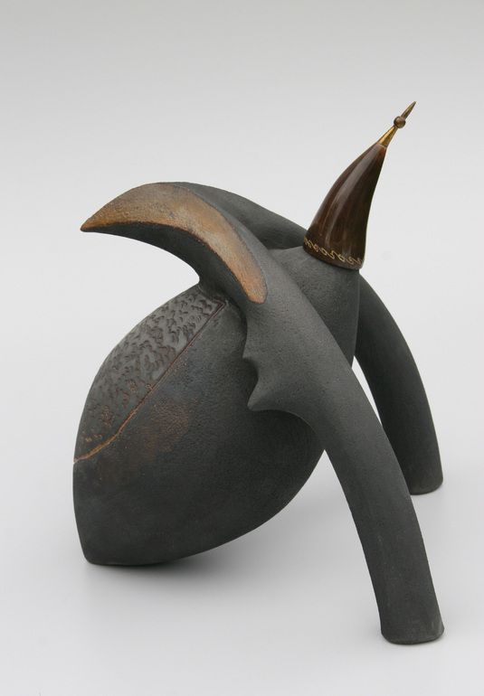 Title: bug,     Material: ceramic, found object,       Technique:oil reduction