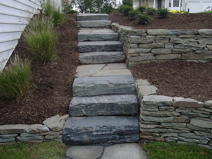 Tiered retaining walls w/ steps. Inspiration only. Side of house.