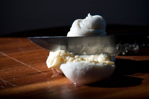 Burrata, meaning 'buttered' in Italian, is a dreamy fresh cheese that consists of a Mozzarella pouch, rather than a ball, filled with a delicate milky-mousse. When you bite into it, the filling gently oozes out. Delicious!