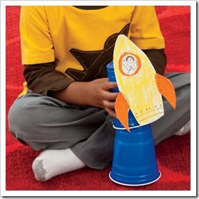 Preschool Alphabet: Rubber Band Rocket Launcher made out of two plastic cups; 2 elastic bands & a rocket coloured in by the children.