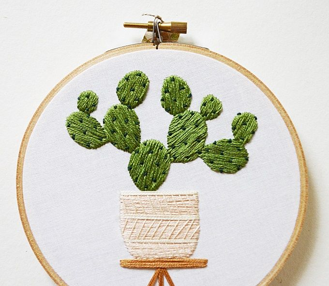 Sarah K. Benning is a contemporary crafts-lady who fills wooden hoops with meticulously-embroidered ferns, cacti, and other potted houseplants.