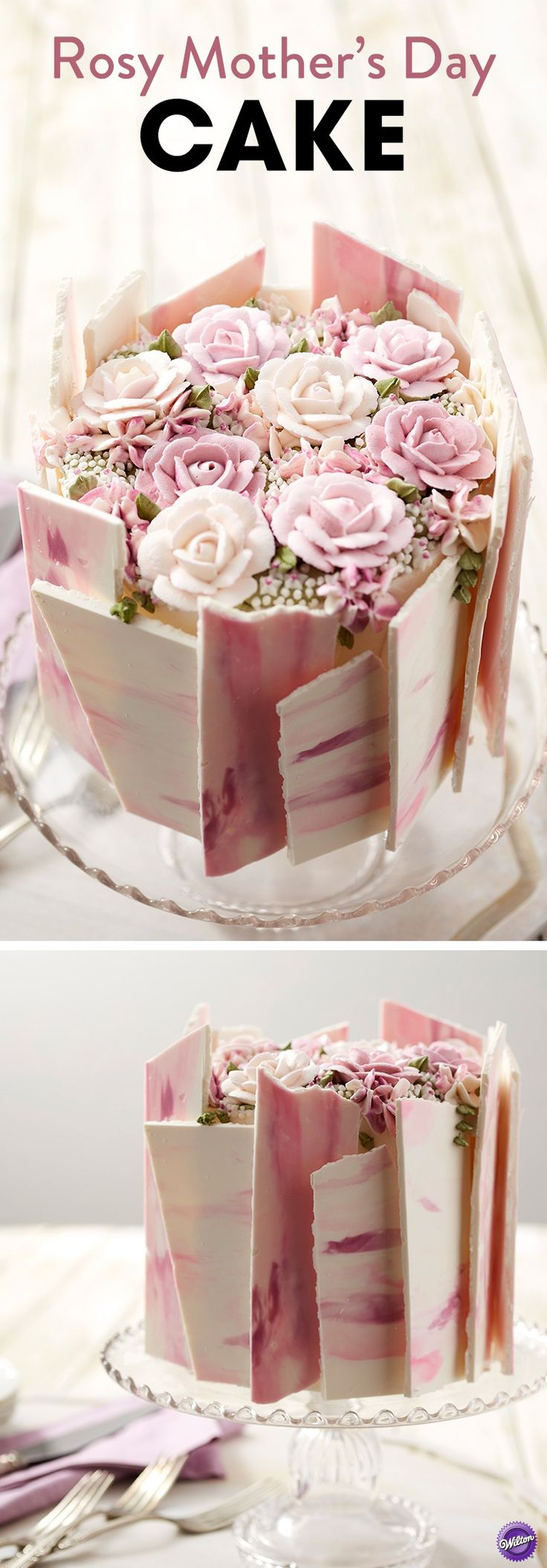 """Nothing says """"I love you"""" like a homemade cake, and what better way to show mom what she means to you than with this Rosy Mother's Day Cake? Topped with beautiful buttercream flowers and decorated with pink and purple candy shards, this lovely Mother's Day dessert is bound to be one edible arrangement mom will love! Layer icing colors in your decorating bags to make your roses look like they're actually blooming, and get ready to wow with this Rosy Mother's Day Cake."""