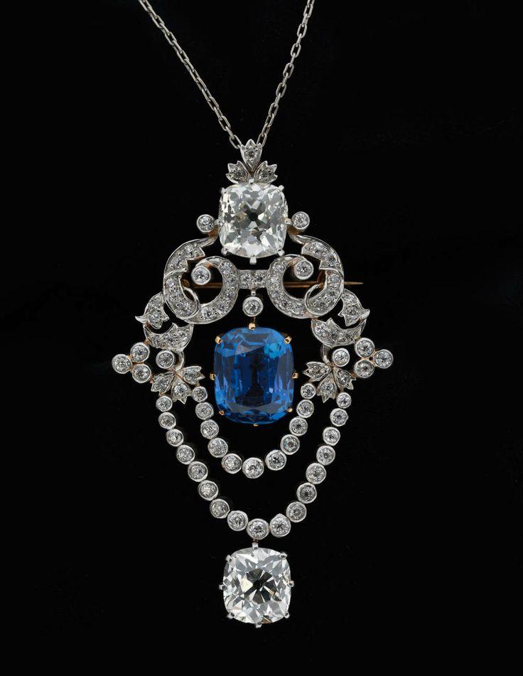 Tiffany & Co. pendant brooch, circa 1900. Platinum, diamonds, sapphire.