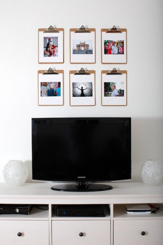 use clipboards to hang photos... now that is a cute idea... and great for changing out pictures easily!