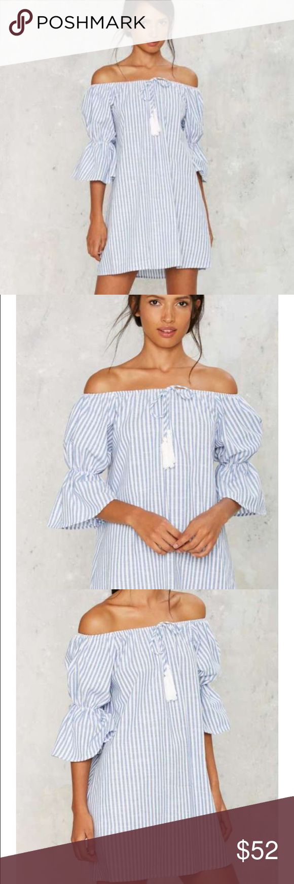 Neat as a pinstripe mini dress. Sold out. Vacation wardrobe solved. This dress features an A-line silhouette, blue and white stripe pattern, off-the-shoulder design, cropped poet sleeves, and tie with white tassels at neckline. Unlined.  *Cotton  *Runs true to size *Hand wash cold  *Imported Nasty Gal Dresses Mini