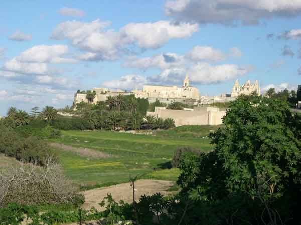 70 Down the valley is Gnien is-Sultan and the fortifications is Mdina, the old capital city of Malta also known as The Silent City.