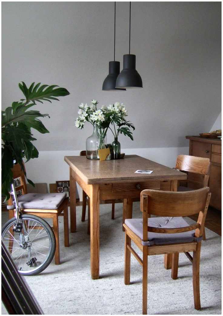 Vintage dining table & chairs with Ikea 'Hektar' ceiling lamps