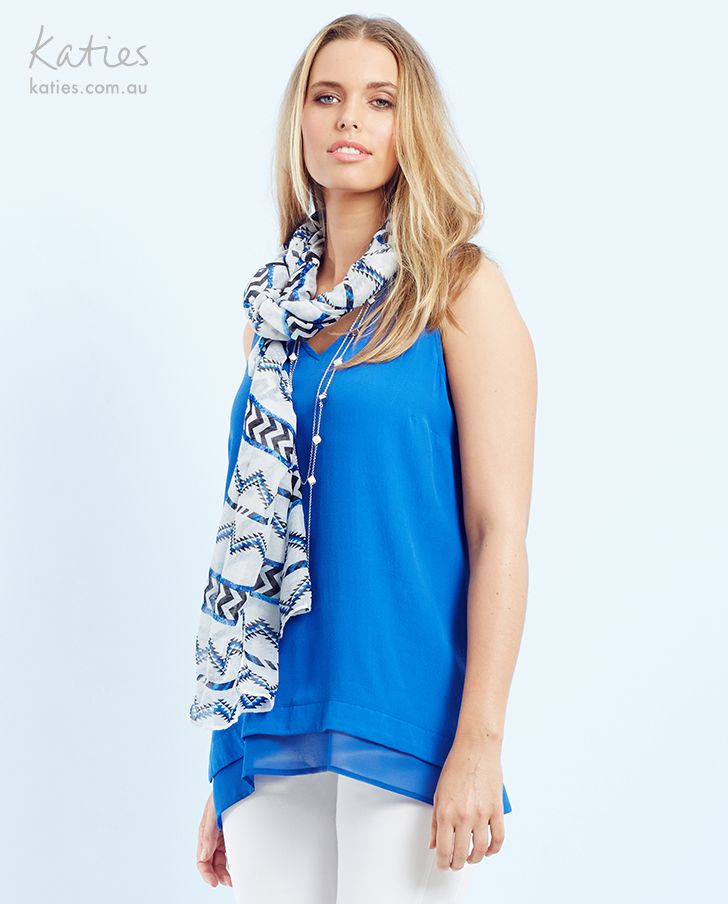 ZIG ZAG SCARF / Play with pattern and colour by layering our zig zag scarf over a bold blue tee for instant style impact.