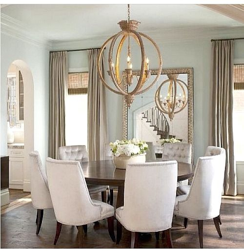 I love the idea of family gathered around a round table you do not see round tables often in a formal dining room the furniture flooring light