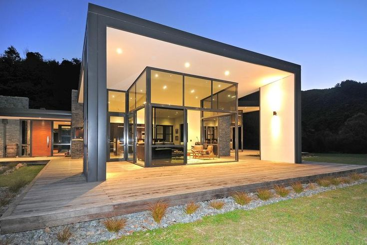 3 Glass Cubed Volumes sheltered under Roof define Sustainable Home ...