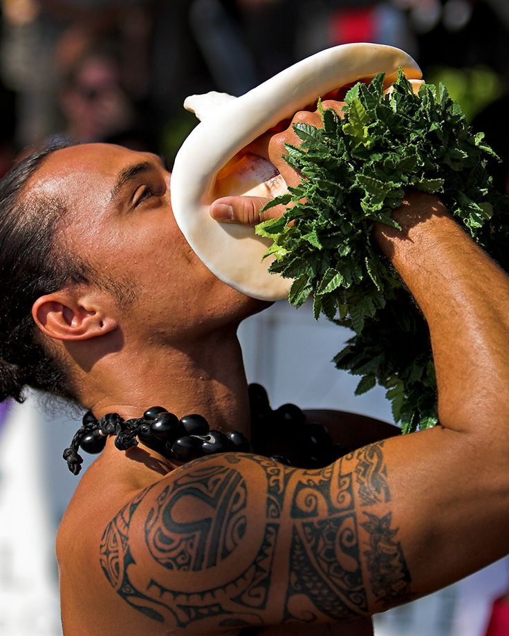 Blowing the Conch at the Polynesian Cultural Center, Oahu.