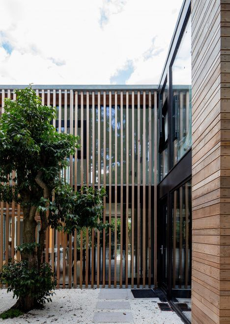 McGarry-Moon Architects adds concrete, timber and glass extension to a…