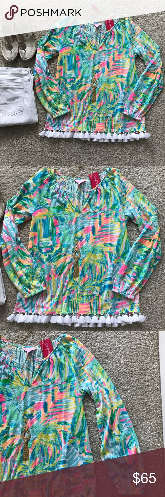 "Lilly Pulitzer Linzy Top Lilly Pulitzer Linzy Top in Sea, Salt & Sun. Gorgeous addition to your Lilly collection. Can be worn casual or dressed up❤️ Draped long sleeves. Tassel detail at the hemline. Notched neckline. Laying flat approx 23"" shoulder to hem, approx 18.5"" pit to pit. 100% cotton. Size XS. NWT. #1289 Lilly Pulitzer Tops"
