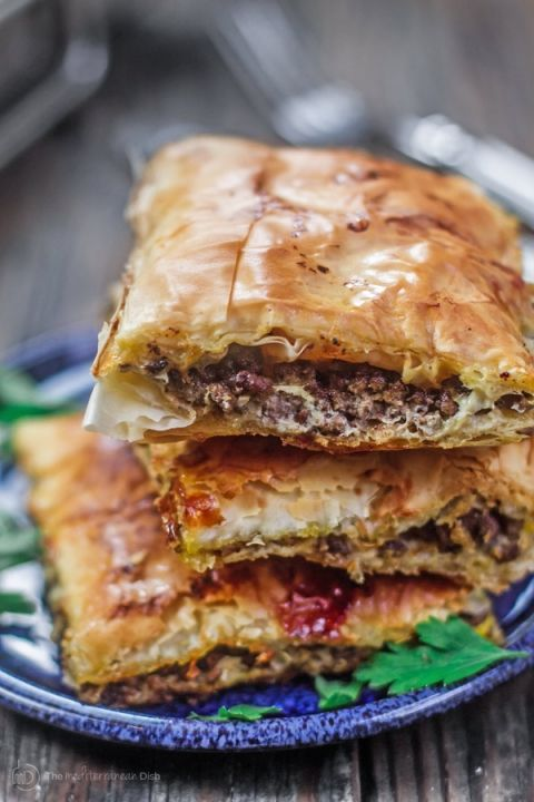 Phyllo Meat Pie Recipe (Egyptian Goulash) | The Mediterranean Dish. Spiced ground beef nestled in between layers of crispy, flaky, buttery phyllo dough! Recipe comes with step-by-step photos. An easy dinner with a big wow factor!