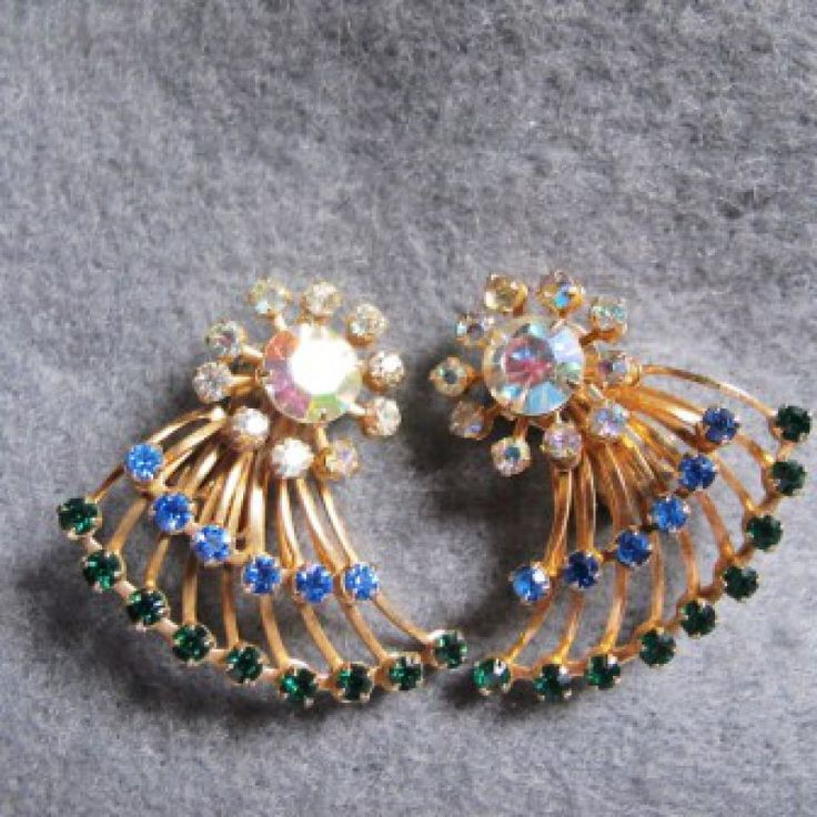 Vintage 1950\'s Fan Style Earrings on Velvet Rose's Pin Up Dressing Room  Very pretty vintage earring, large single stone on the ear, fans out with gold bars and 2 rows of crystal chatons, one row of emerald green and one row sapphire blue