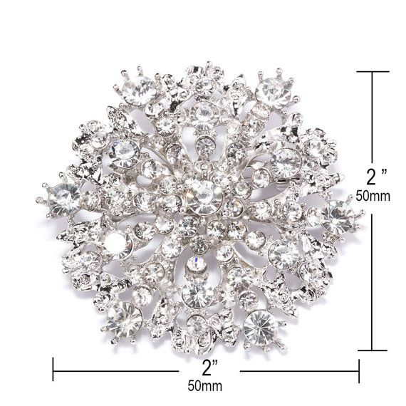 This listing is for 1 of our beautiful sparkling Rhinestone Brooch Embellishments, which can be used for invitations, brooch bouquets, cake decorations, ring pillows, event decor, crafts, scrap booking, and more!    DETAILS:    -Quantity: 1    -Price: only $ 2.6 /each!    -Measurements Inches (Approx): 2 x 2    -Measurements Millimeters (Approx): 50mm x 50mm    -Stones: Grade A+ CLEAR Glass Rhinestone Crystals    -Metal Plating Color: Antique Silver    -Product Number: 407-S    For diffe...
