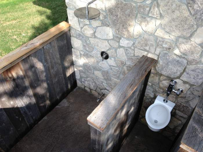 Rustic outdoor Shower and Urinal for pool house