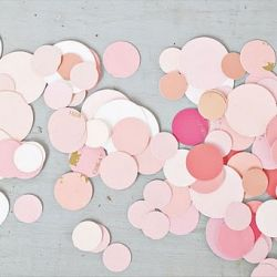 Making DIY confetti from paint chip samples at a paint store--good for customized confetti for your wedding colors