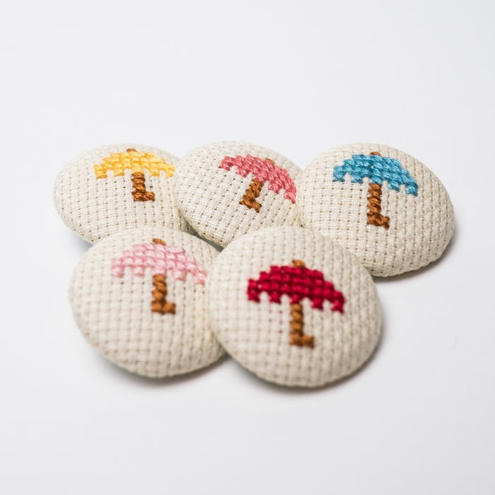 5 Buttons Fabric - Umbrellas Cross Stitch - 32mm. €7.00, via Etsy.