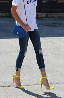 Celine tee, skinny distressed cropped jeans, bright neon louboutins, chanel cross body purse.
