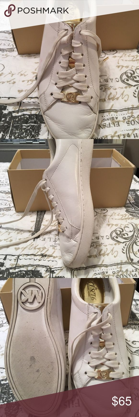 White w/gold Hard ware tennis shoes Great for summer white with gold hard ware tennis shoes shorts dresses bathing suits get ready summer!!! KORS Michael Kors Shoes Athletic Shoes