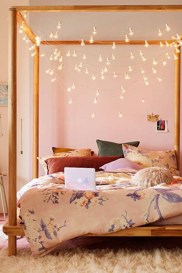Create this light look with hooks and low wattage lights above the bed