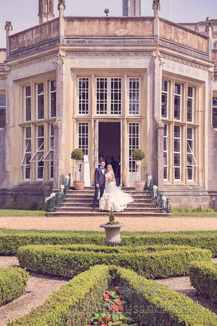 Wedding couple in sun at Highcliffe castle wedding. Photography by one thousand words wedding photographers