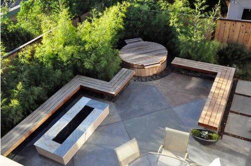 modern hot tub, natural wood bench seating along perimiter of patio with hot tub