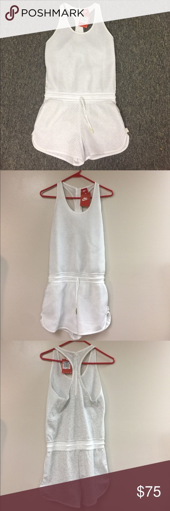 "Nike XS white gray tennis shorts jumpsuit romper One piece Nike XS women's tennis romper in gray and white. Zips up the back, elastic drawstring at waist, pockets. Breathable mesh fabric. Brand new. Face of body fabric 100% cotton, back of body fabric polyester. Machine wash cold, tumble dry low. Size extra small. Pit to pit measurement is 16 inches (32"" bust) waist measurement 30 inches, length 31 inches. Nike Shorts"