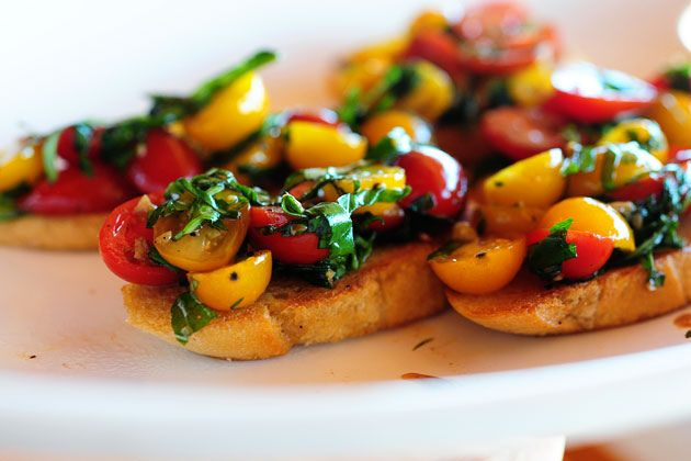 Red & yellow grape (or cherry) tomatoes, garlic, olive oil, balsamic vinegar & fresh basil on Bruschetta