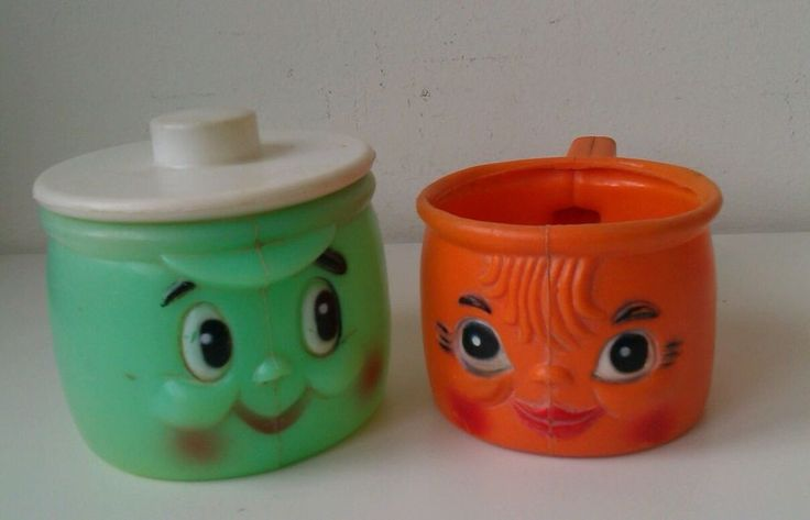 vintage Mothercare toy saucepans x2 with faces one green with lid and orange one