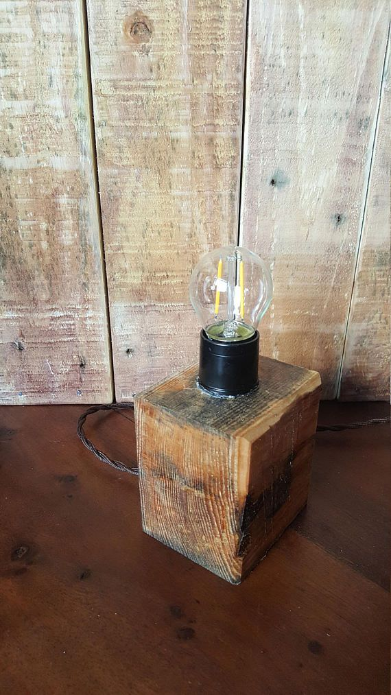 Solid Oak Desk/Shelf/Table lamp with LED bulb and twisted fabric cable  Handmade and cut from a solid block of recycled hardwood this rustic lamp comes with a 40w LED bulb and a standard 3 pin UK plug  Very quirky and would compliment any part of any room