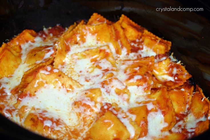 CROCKPOT RAVIOLI  25oz bag ravioli, 1jar spaghetti sauce, 1c mozzarella, dump ravioli into crockpot, pour sauce in, stir evenly & carefully, cover and cook on high for 2.5-3hrs, add cheese and let melt.