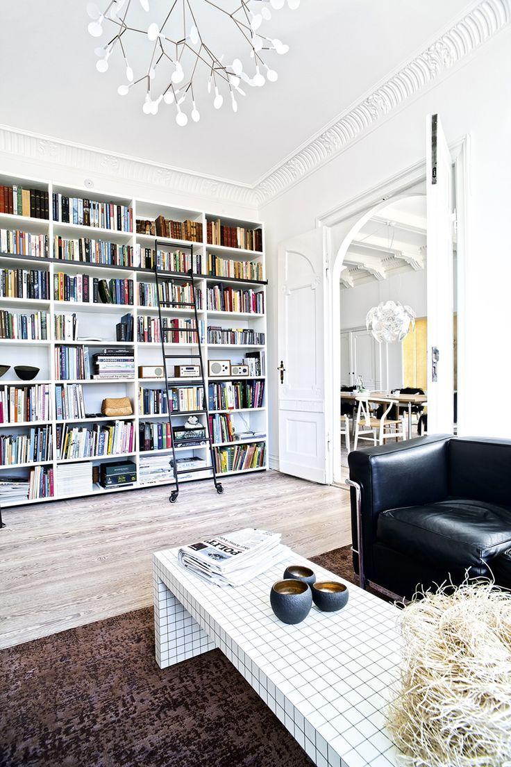 Danish designer Annemette Beck home. Love the chandelier and book shelves.