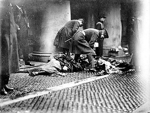 Triangle Shirtwaist Factory Fire: Officers with Bodies of Victims on the Sidewalk