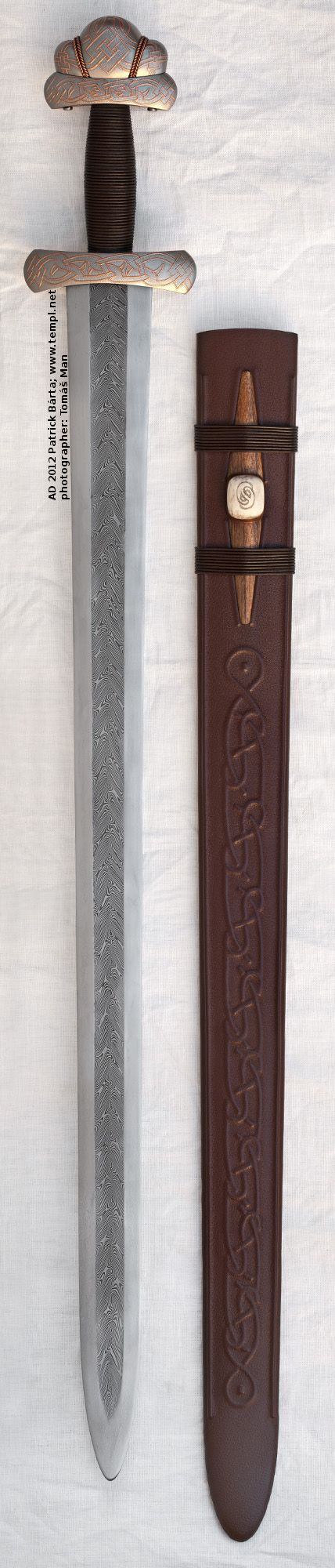 Viking sword with scabbard full view, hilt from cooper inlay iron, pattern-welded blade, other possibility of reconstruction. 8th Century. Gjermundbu, Norway.
