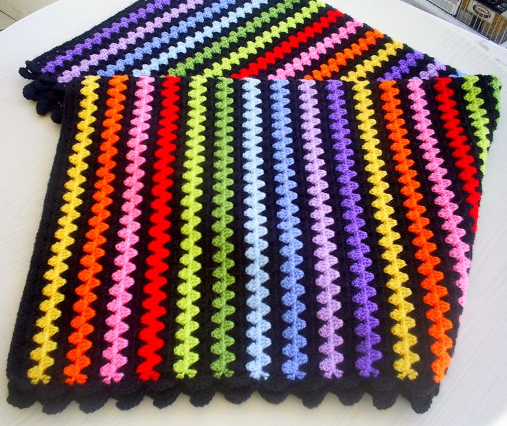 granny stripe blanket--picture only. Would make cute boot cuff pattern. Like the black with the colors.
