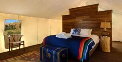 Browse Tents and Wagons View Rates View floor plans & photos» Grand Tents Grand Tents are ideal for couples and families who want premium luxury. Each features an en suite bathroom with shower, electricity, Western-style furnishings, safe for valuables,
