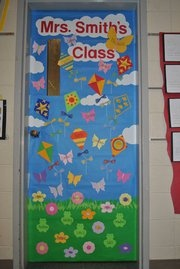 Spring Classroom Door - The background and grass are from the large butcher block paper at craft stores and parent teacher stores.  Everything else is colored cardstock.  The kites have yarn strings and fabric tails (cut with pinking shears).  The teacher's name is on the large butterfly at the top (its wings stick out, away from the door).  The boys' names are on kites and frogs and the girls' names are on flowers and butterflies.  They loved finding their names on the door!