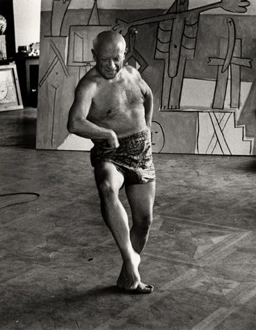 Pablo Picasso dancing in his studio.  Douglas Duncan
