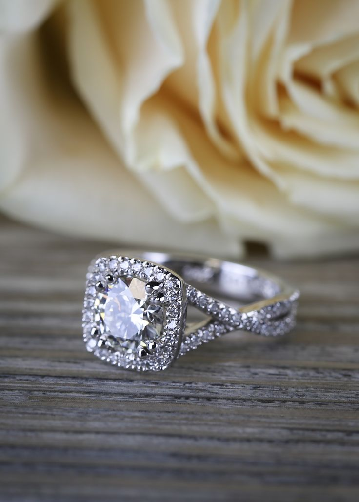 A Twisted Split Shank Halo Diamond Engagement Ring in White Gold!