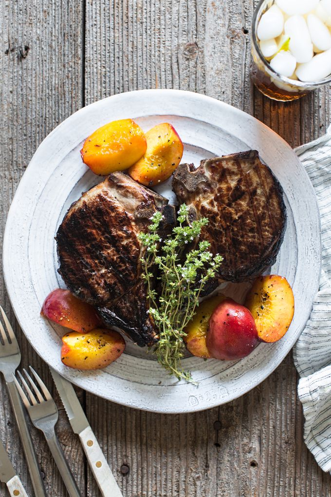 My latest summer grilling recipe: Sweet Tea Pork Chops with Grilled Peaches. These juicy pork chops are simple and packed with flavor.