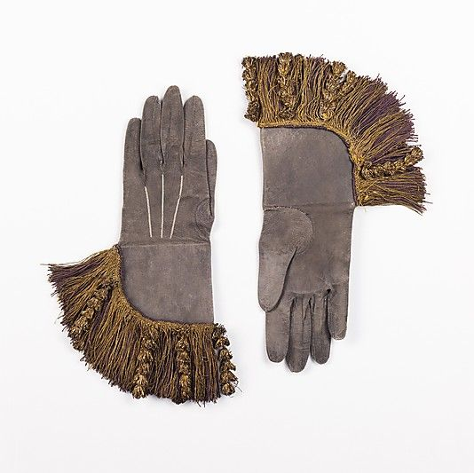 Gauntlets  Date: 1680–1710 Culture: British Medium: leather, silk, metal Dimensions: 14 in. (35.6 cm) Credit Line: Brooklyn Museum Costume Collection at The Metropolitan Museum of Art, Gift of the Brooklyn Museum, 2009; Museum Expedition 1923, Frederic B. Pratt and Frank L. Babbott Fund, 1923 Accession Number: 2009.300.2934a, b  This artwork is not on display