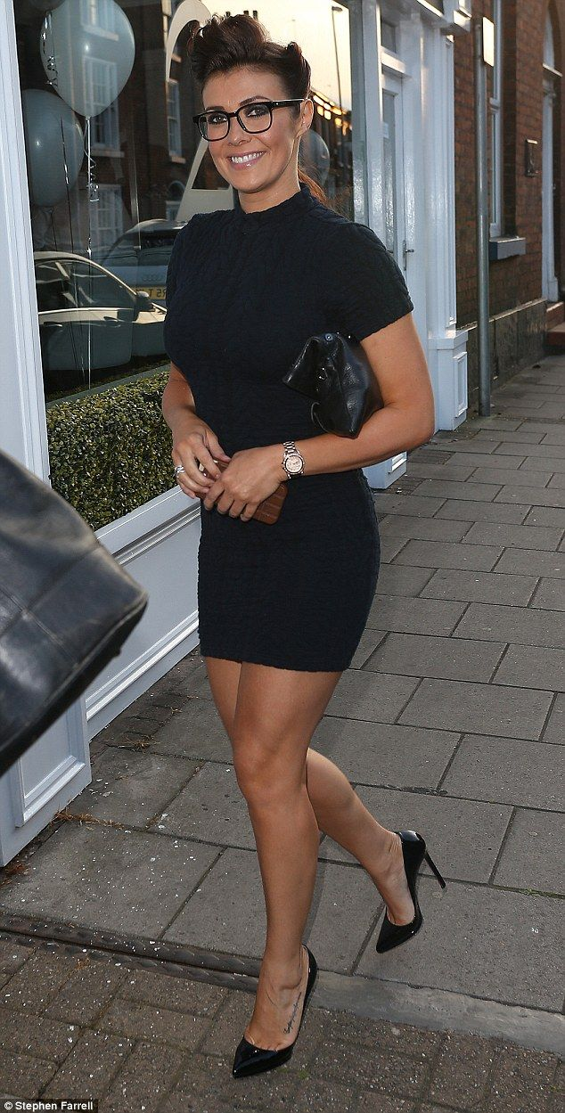 Dressed to impress: Kym Marsh put her toned and tanned figure on display in a skintight LB...