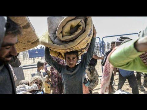 Texas amenaza con demandar a quienes ayuden a los refugiados sirios