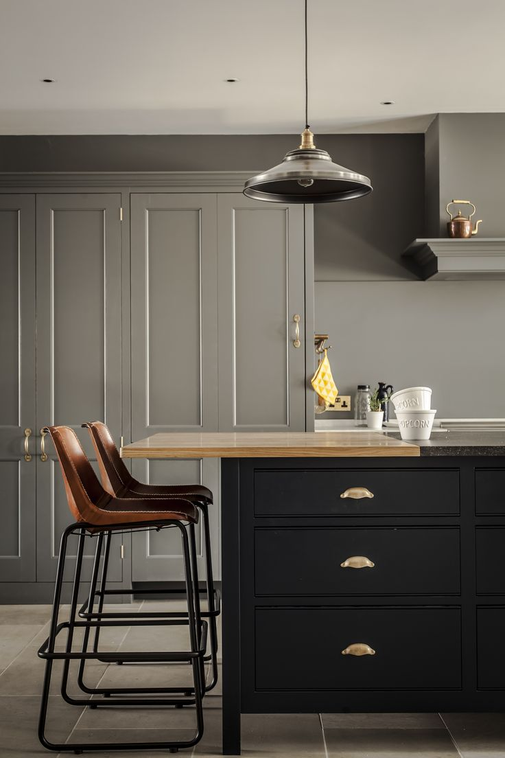 Plain English Osea Island with a bespoke marble and Oak wooden worktop in the Greenwich Park.  Plain English Spitalfields cupboards with Georgian cornice.  Bespoke.  Panelled doors.  Hand painted. plain seating
