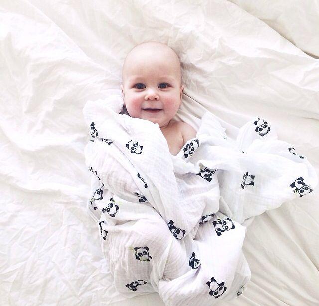 Adorable baby with Lulujo Panda blanket.
