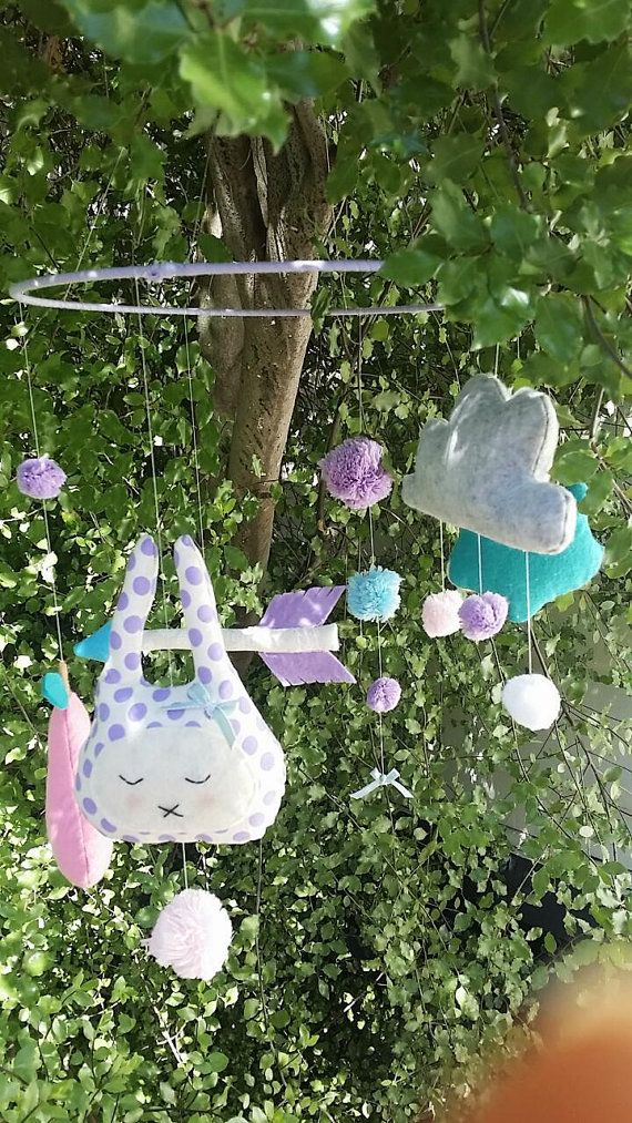 A unique baby mobile/ children's room decor. Featuring bunny girl, cloud, arrow, pear, fox and pompoms. Inspired by trending items