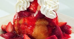BJ's Brewhouse New Orleans style  beignet with ice cream, whipped cream and strawberries